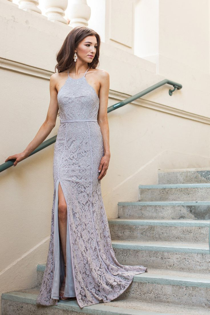 Hello gorgeous! As if the lavender-grey color alone wasn't enough to want to wear this every single day, the halter cut and high slit of this flattering maxi dress has us completely head over heels. T