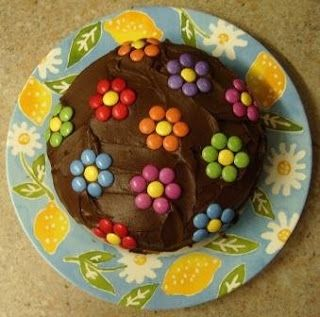 "Easy flower cake. SUPER easy and still adorable. Can't go wrong with that! Plus, I wanted Kylie May to have a chocolate cake this year, so this will work wonderfully! I'll just write ""Happy Birthday Kylie"" in icing on the plate itself and stick the #5 candle on top."