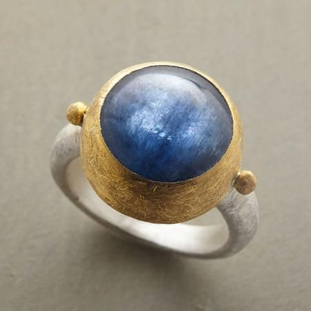 kyanite dome ring | $990 | This Nava Zahavi blue kyanite cabochon ring makes a sumptuous impression. A Nava Zahavi blue kyanite cabochon ring, in which the designer accentuates glassy blue kyanite with her richly textured setting: a 14kt gold bezel and sterling silver band. Handcrafted Sundance exclusive. Whole sizes 5 to 9.