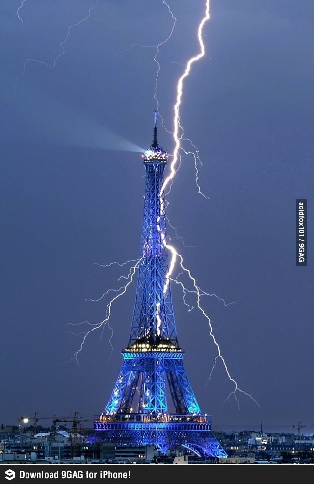 The Eiffel tower getting struck by lightning