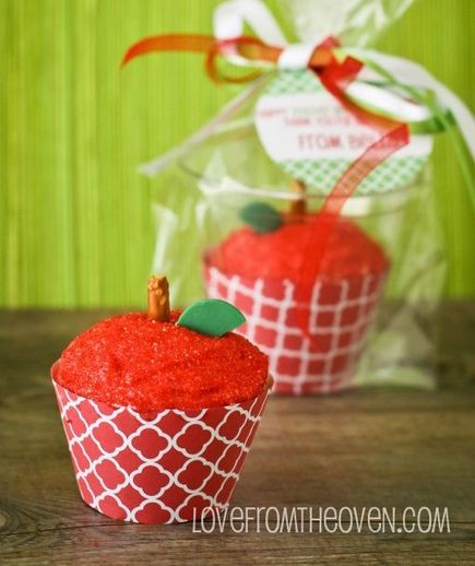 "Apple For the Teacher Cupcakes: Celebrate your child's favorite teacher with—what else?—an ""apple."" Cover a frosted cupcake with red sanding sugar; add a pretzel stick and top with a green candy."