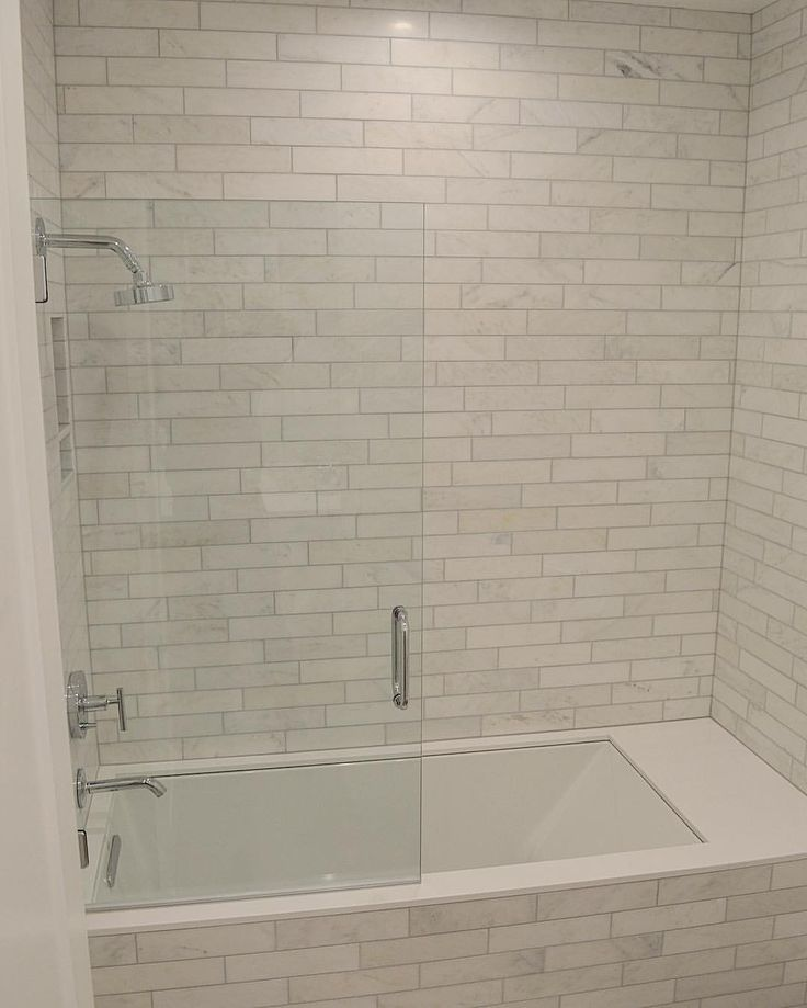 Marbel tile tub surround with gray grout