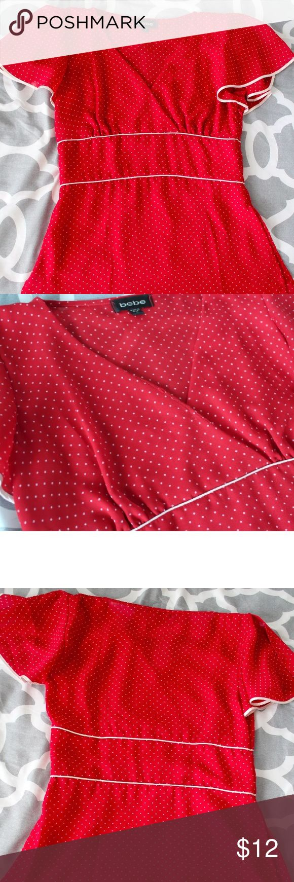 """Bebe Retro Style polka dot Crossover Top is beautiful top is in excellent preowned condition. It is a size small but has been altered. It measures 16"""" across the chest and it is 24"""" long from shoulder to hem, making it fit more like a size xs. On the crossover part of the top there is a small pinhole. Please zoom in on pics. All of our items come from a smoke free home. bebe Tops Blouses"""