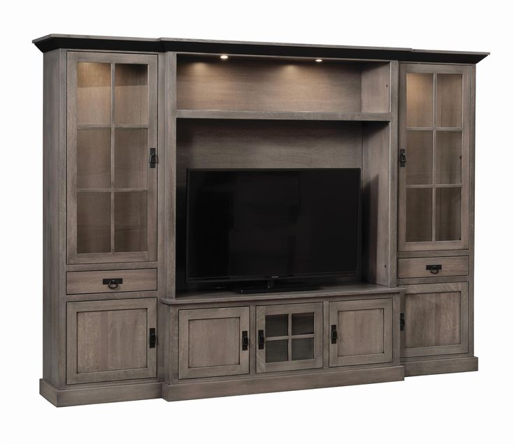 Amish Lynwood Wall Unit All you need for organization, storage and display in the living room is included in the Amish Lynwood Wall Unit. Solid wood furniture handcrafted with care ensures the Lynwood is the last entertainment center you'll ever have to buy. Select a custom width to fit your space.