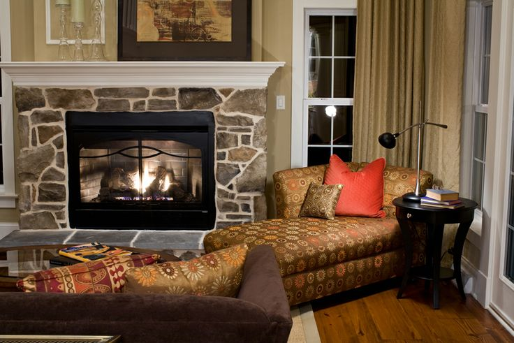 fireplace with stone veneer to mantle height a white trim mantel and