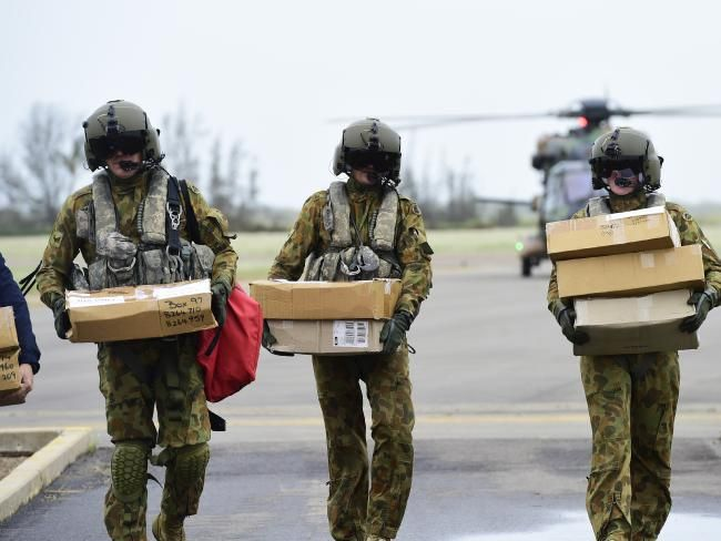 Australian Defence Force personnel bring some relief items to Bowen after Cyclone Debbie hit the area. Picture: Wesley Monts/News Limited