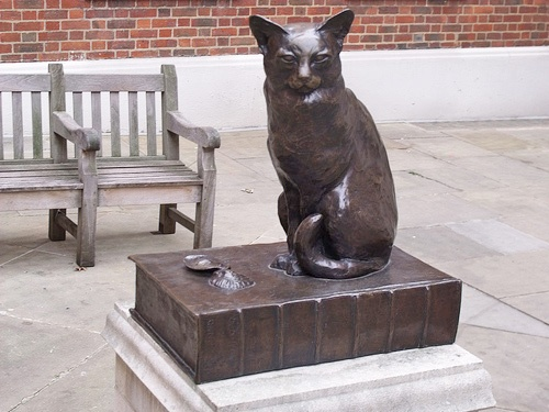 17 Gough Square, London, was the home of Dr Samuel Johnson (1709-1784), which he shared w/ his much loved cat, Hodge. Not many cats have a statue erected in their honor, but opposite the house, which is now a museum, stands a charming bronze of this famous 18 c. feline. Dr. Johnson lived in the house for 11 years, & it was here that he produced the dictionary for which he is famous. Like many writers, he had a fondness for cats. Hodge kept him company as he labored on his mammoth task for…