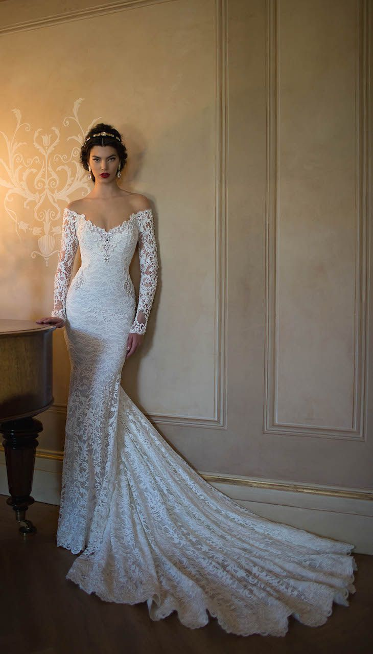 Show-stopping off-the-shoulder lace wedding dress by @bertabridal