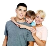 Happy young family with son of 6 years posing over white background stock photography