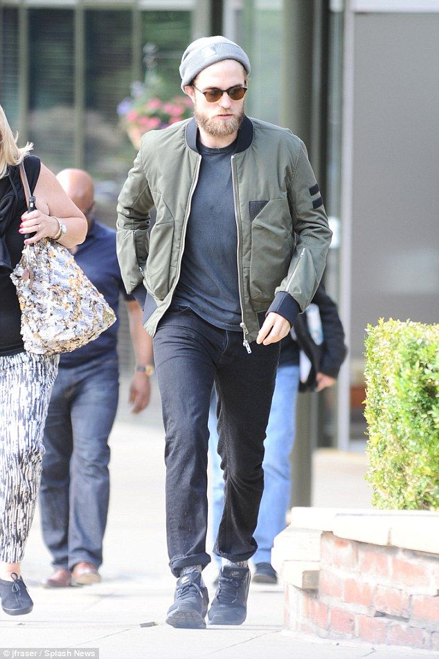 Robert Pattinson sports bushy hipster beard as he visits