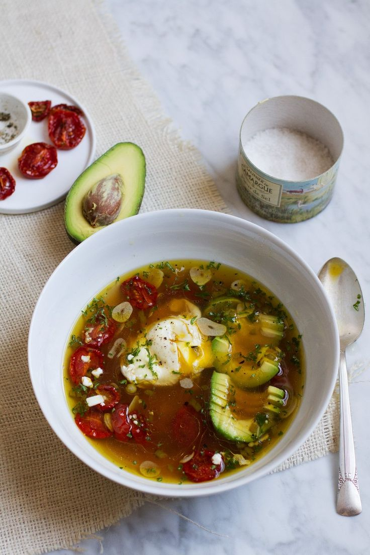 Brothy Garlic Soup with Slow-Roasted Tomatoes and Poached Eggs | http://saltandwind.com  | @saltandwind