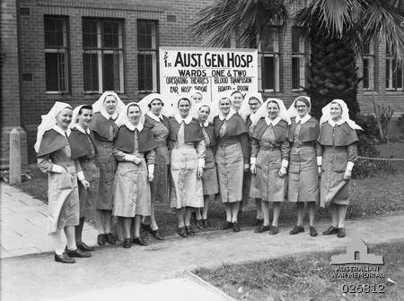 A group of Australian Army Nursing Service sisters who had served in the Middle East with the 2/1st Australian General Hospital in front of a building occupied by the unit at Guildford, Western Australia in September 1942 ~