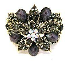 Vintage Inspired Deep Purple Black Flower Rhinestones Fashion Cuff Bracelet AMR Collection. $23.99. Vintage Inspired Deep Purple Black Flower Rhinestones Fashion Cuff Bracelet. Central purple black floral motif.. Bracelet Length 7 inches.  No Clasp.. This Fashion Cuff Bracelet has an antiquated brass look.. Decorated with rhinestones.