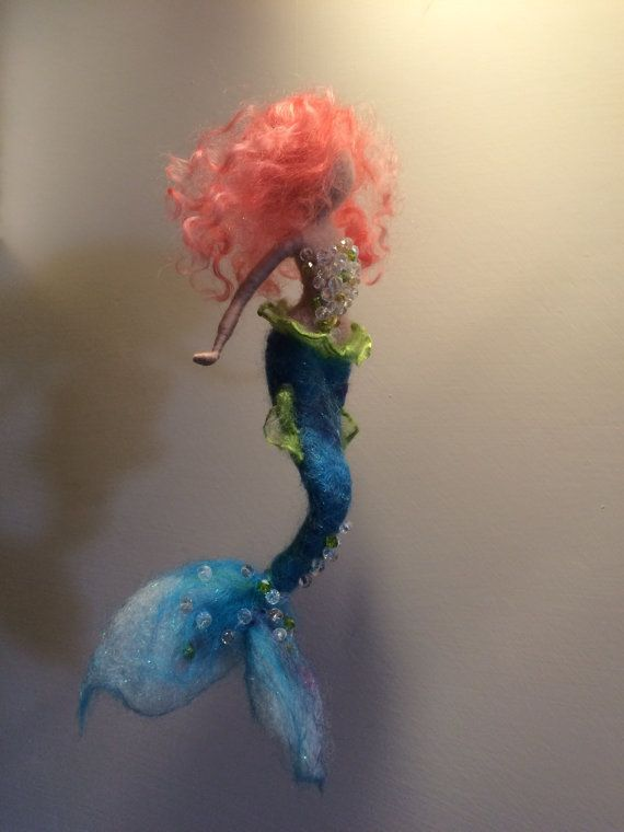 This beautiful sparkling hanger decorate every corner of your home. It can be a decoration in the nursery. The mermaid is made of wool and iridescent cotton and embroidered with crystals. The height is 18 cm.