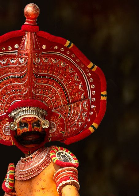 """Man Dressed For Theyyam Ritual With Traditional Painting On His Face, Thalassery, India"" by Eric Lafforgue on flickr.com"