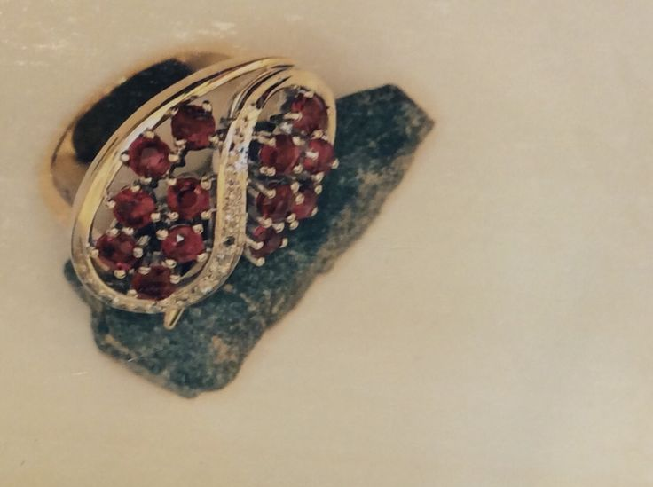 Ruby and diamond swirl ring in white gold