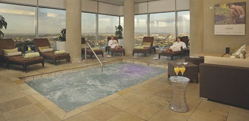 RADISSON BLU HOTEL SANDTON JO -Guests at the Radisson Blu Hotel Sandton Johannesburg can enjoy a dip in the stylish outdoor swimming pool and adjacent sun deck, located on the 9th floor of the hotel . After a long day of sightseeing or business meetings, guests can also relax with a visit to the hotel's wellness and fitness center .
