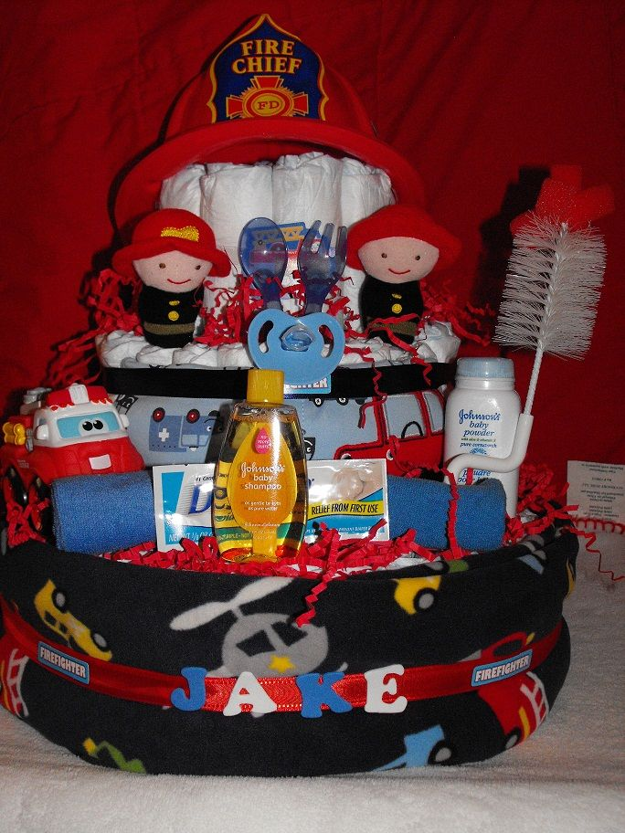 Firefighter Diaper Cake (includes a baby spoon and fork, two wash cloths, a onesie, a firefighter helmet, a pacifier, baby shampoo, baby powder, a bottle scrubber, two firefighter finger puppets, a Tonka fire truck and rescue car footed pjs)  | Shared by LION
