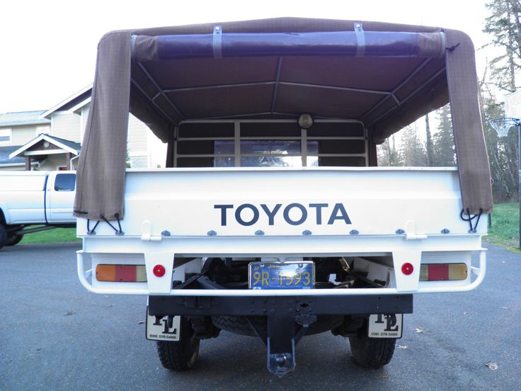 FJ45 Toyota Land Cruiser: flat bed, drop down removable sides, steel frame canvas topper...LOVE IT!