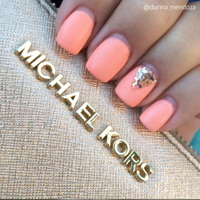 Matte, coral nails with a gold, glitter accent ✨ Instagram: @nailsbydianna_