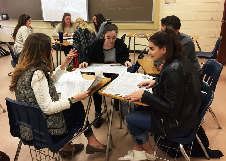 Northport, N.Y., High School seniors look for examples of direct evidence and verified information in news stories.