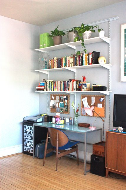 small space desk with shelves: greta use of shelving and color in a small home office work space