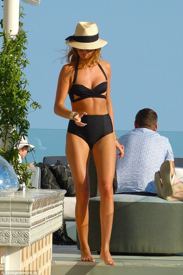 Balearic babe:  Millie Mackintosh stands out in bold cut-out bikini during her recent trip...