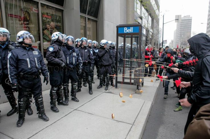 Montreal student protesters baiting riot police with donuts. #Winning (taken 2+ weeks ago)