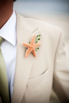 And here is the groom. Starfish boutonniere for a #beach #wedding #theme