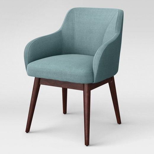 Bring the perfect blend of modern design and functional style with the Marshad Modern Arm Anywhere Chair from Project 62™. Crafted from solid hardwood for strength and durability, then upholstered in a teal fabric, this accent chair will instantly enhance any room it's placed in. The curved back and clean lines complement the modern aesthetic of the chair's long, cone legs, making it a stunning piece to place near a sectional in the living room or in the corner of your home o...