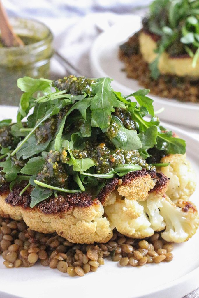 Cauliflower Steaks with herbed lentils, arugula, and roasted pistachio mint pesto  The Mostly Vegan