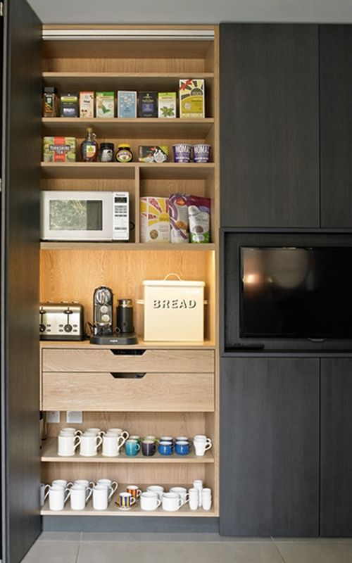 The microwaves in these kitchens are built-in beautifully under counters or in appliance towers, and hidden behind doors in dedicated appliance cabinets.