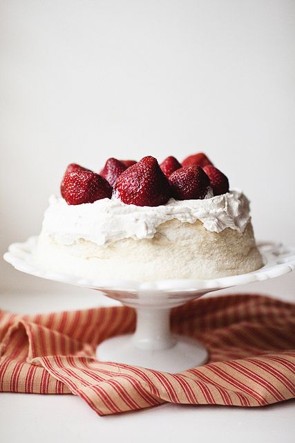 Angel Food Cake  400g icing sugar  1/4 teaspoon salt  230g cake flour, sifted  12 egg whites (at room temperature)  1/3 cup warm water  1 1/2 teaspoons cream of tartar  Whisk egg whites, water and cream of tartar.  Beat in half the sugar plus salt to medium peaks. Sift and gently fold in the rest of the sugar with the flour a little at a time.  Carefully spoon mixture into an ungreased tube pan. Bake for 35 minutes at  180 deg C. Cool upside down in the tin for an hour.
