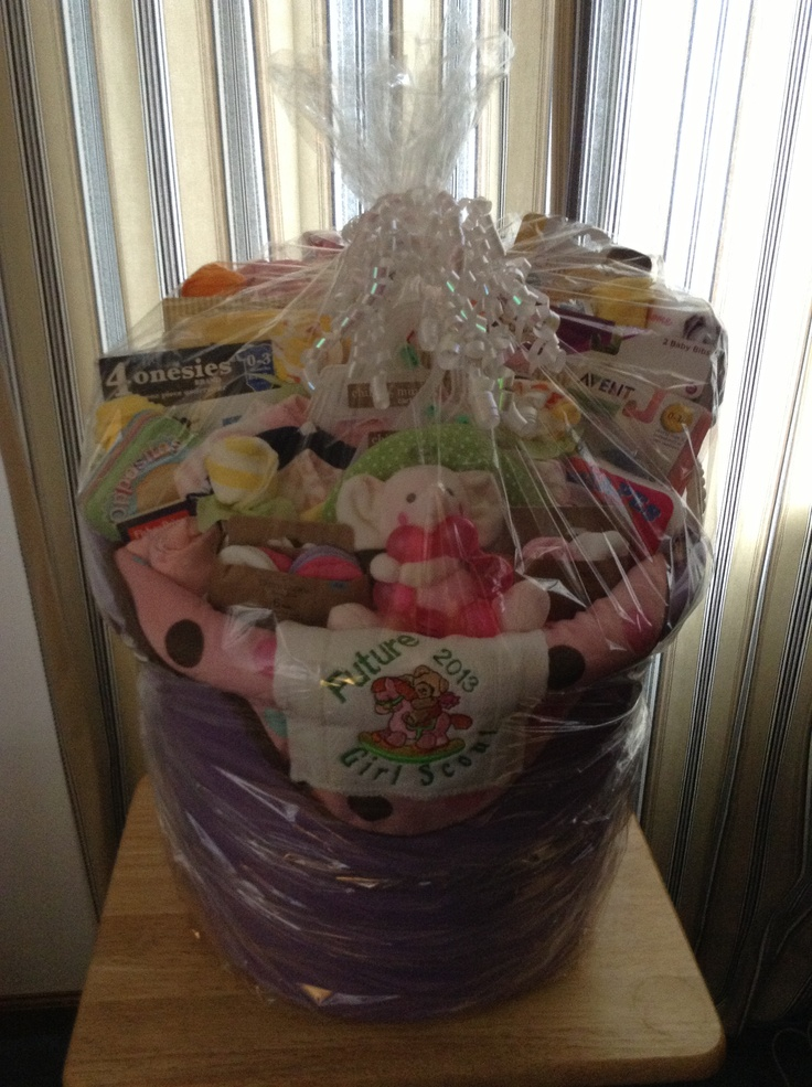 I put this together for my Girl Scout Service Unit. We donate a gift basket to the first baby girl born during Girl Scout Week at our local hospital! This is my first time ever putting together a basket. I added baby wash cloth roses through out the basket. I think it turned out great!