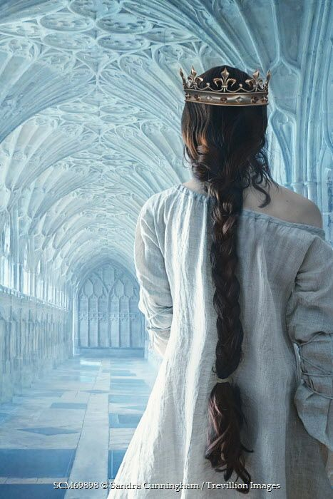 Sandra Cunningham Woman in long cotton chemise and crown walking in Abby corridor