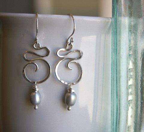 Sterling Silver Swirl Earrings                              …