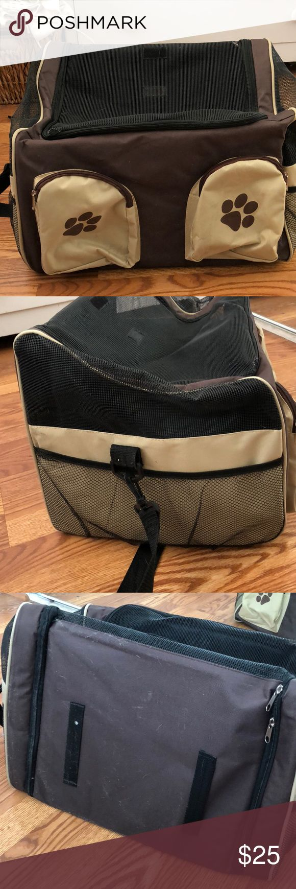 Pet dog car seat carrier I bought this thinking my dogs would be well behaved enough to sit in there while I drive . Like new , just dusty from being in the shed. I got my Pomeranian and chihuahua and both fit  . It's meant to be a car carrier . You put your seatbelt through the two black spots you see in the photo . It has side pockets to store food . Leashes etc it's about 20 inches long 12 inches high and 12 inches wide . You could fit one dog maybe up to 20 lbs (chitzu, poodle type of…