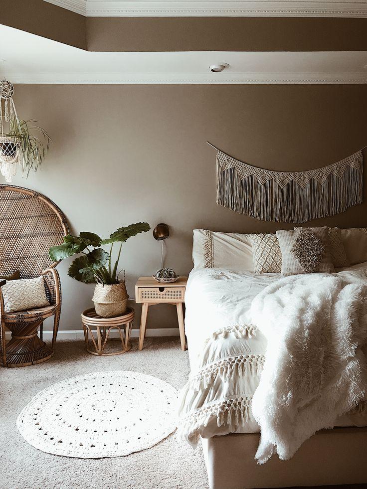 Boho neutral bedroom decor. Vintage peacock chair. Fringe