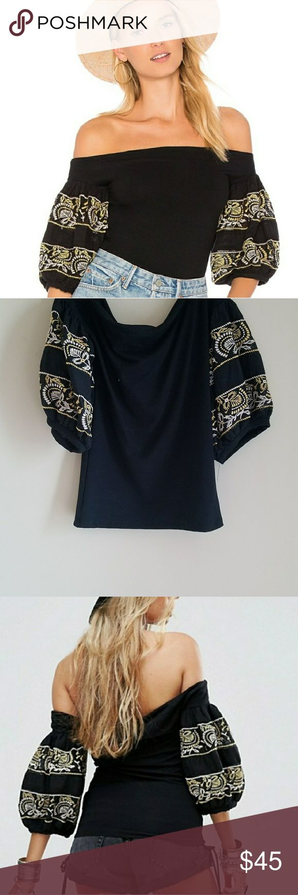 Free People rock with it embroidered top Soft touch stretch fabric Bardot neck Balloon sleeves Regular fit true to size Off the shoulder  Embroidered details Machine wash 87% rayon 13% elastane Free People Tops Blouses