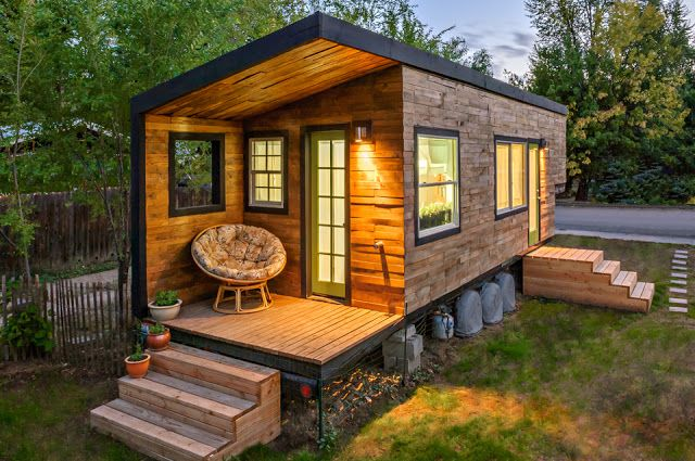 For just $11,416.16, a woman built this tiny house on wheels. She lives here with her partner, two children, and a Great Dane in Boise, Idaho.