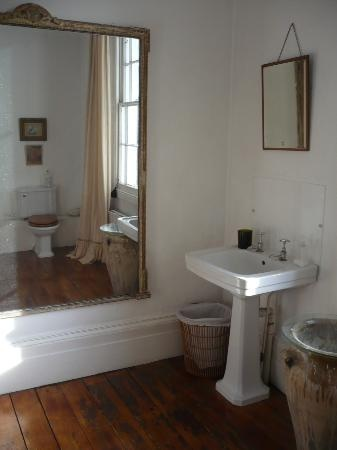 Guest Bath-  Loving the huge mirror and I'm going to reuse our old wood floors.