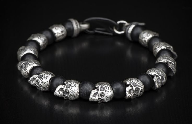 Beaded skull bracelet with sterling silver, frosted black onyx, and black stainless steel.