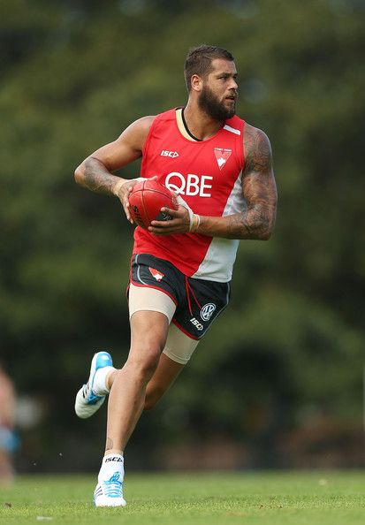 Lance Franklin runs with the ball during a Sydney Swans AFL training session at Lakeside Oval on January 27, 2014 in Sydney, Australia.