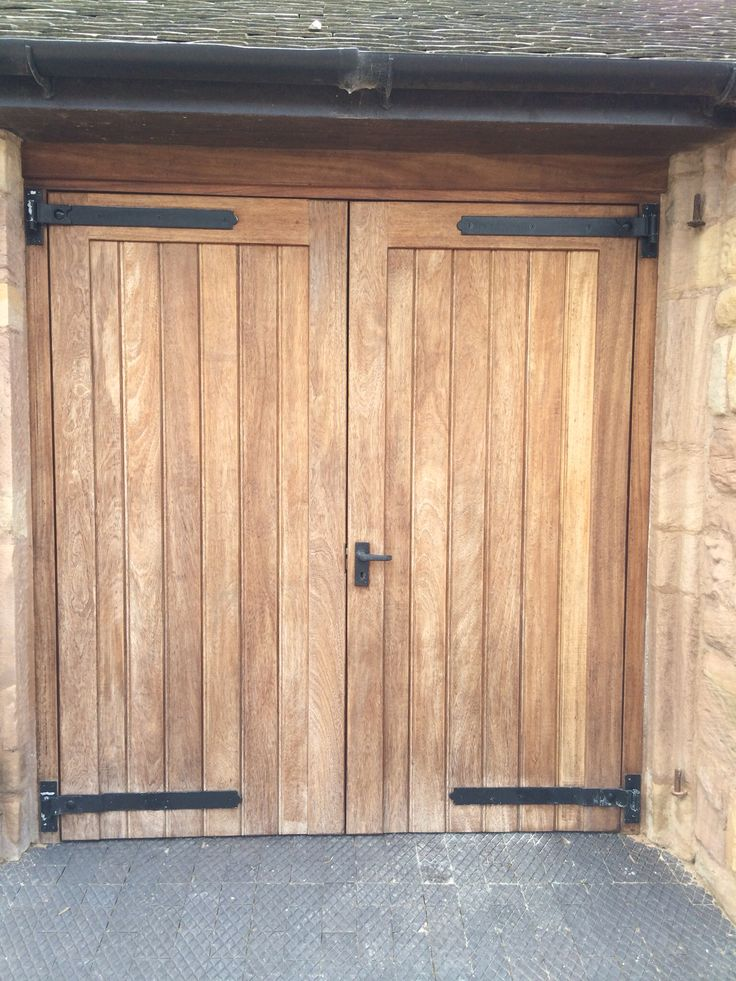 Iroko garage doors after a few years of weathering  Looks beautiful against  the Derbyshire sand. 34 best Garages with living images on Pinterest   Garages  Garage