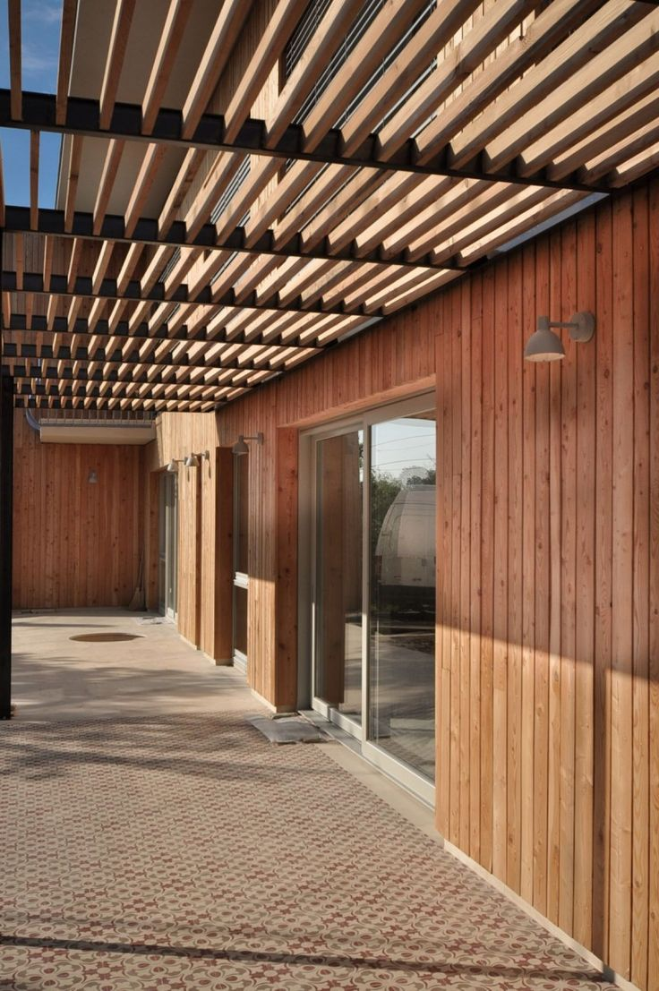 the larix house by corvin cristian wooden walls canopy and house - Ceramic Tile Canopy Design