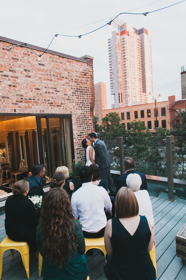 An intimate wedding ceremony on the rooftop terrace of Chicago's Little Goat Diner