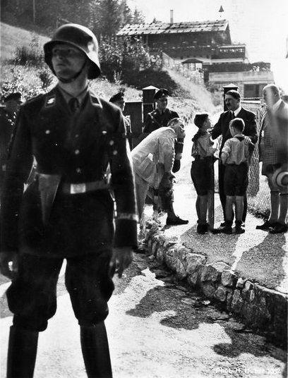 Hitler in 1933 in front of his home, Haus Wachenfeld. Brueckner stands to the left.