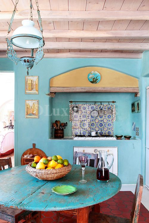 All my colors and the natural wood to boot!  Not at all what I want my end product to look like, but finally an inspiration that matches my Rustic Chic meets Moroccan style! Traditional Mediterranean light blue kitchen, Fiore Arduino, Mykonos