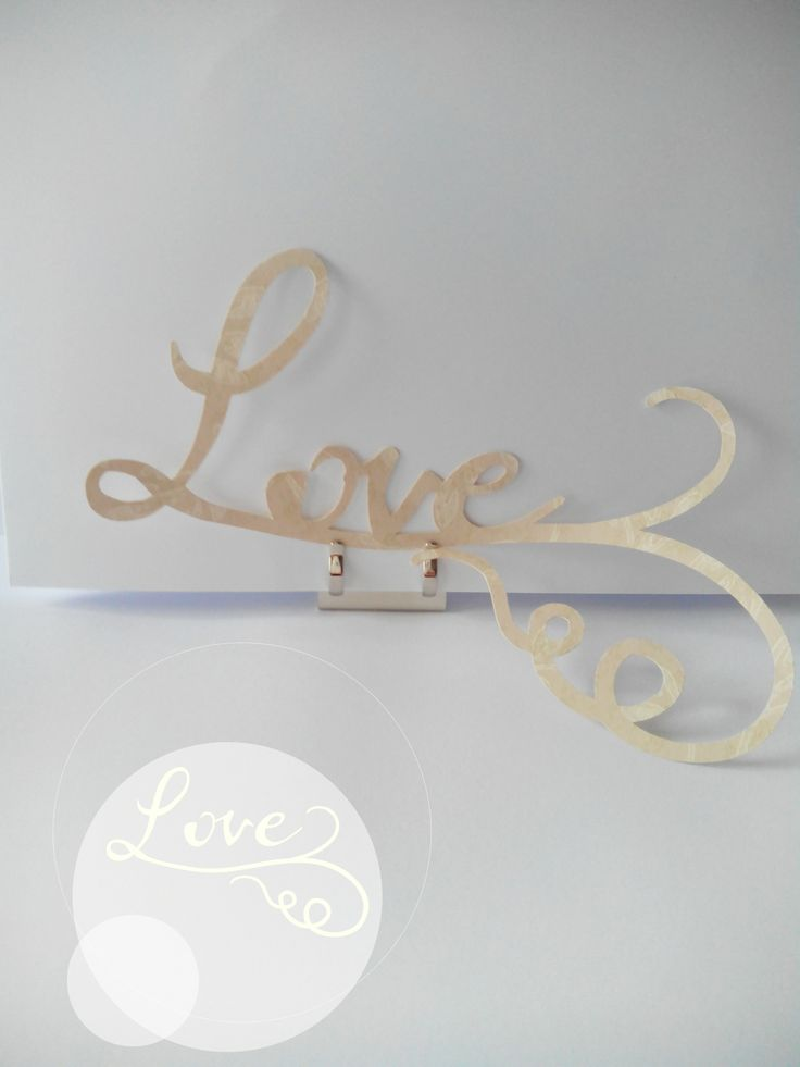 """Love"" cut out with Laura Ashley wallpaper. Design: Noa Magpie"