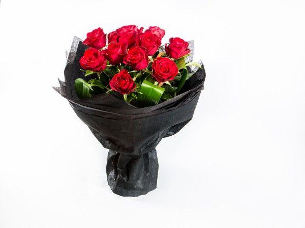 12 Long Stem Red Roses in a glass vase. www.fleurus.com.au